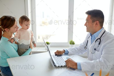 woman with baby and doctor with laptop at clinic