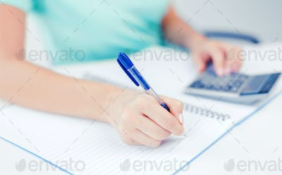businesswoman working with calculator in office