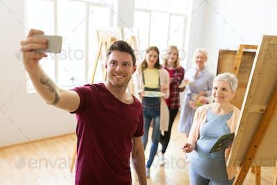 group of artists taking selfie at art school