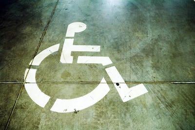 Disability sign on grunge garage floor