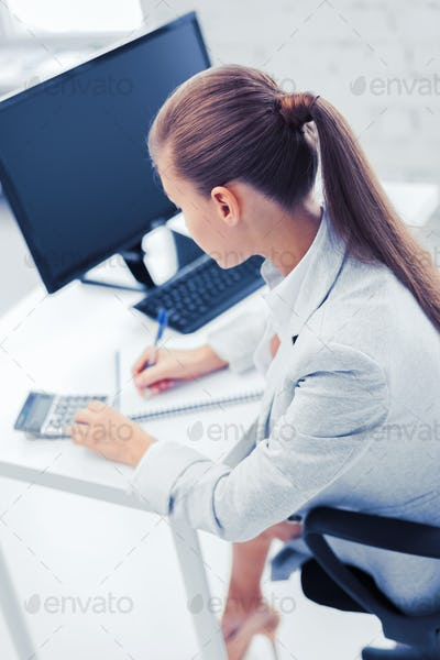 businesswoman with notebook and calculator