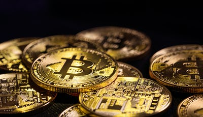 Golden shining bitcoins background
