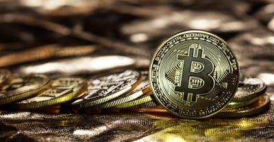 Bitcoins stack on golden background
