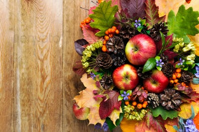 Fall greeting with apples, blue flowers and green leaves