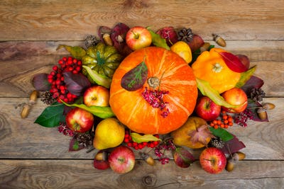 Thanksgiving arrangement with pumpkins, apples, pears, colorful