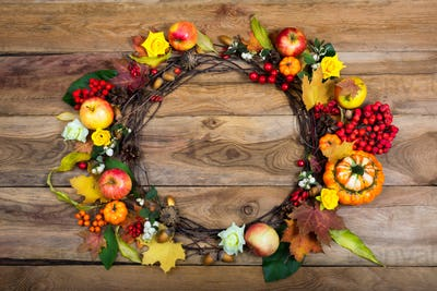 Thanksgiving door wreath with pumpkins and yellow roses