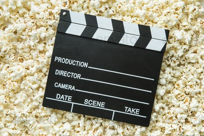 Clapperboard and popcorn.