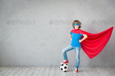 Child pretend to be soccer superhero