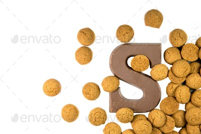 Handful of Scattered Pepernoten cookies with chocolate letter