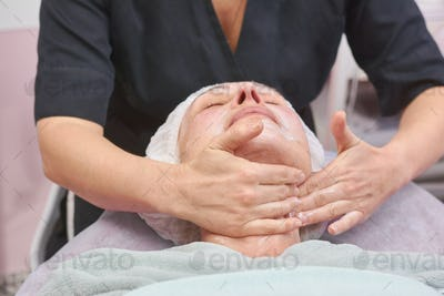 Lymphatic face massage, adult woman