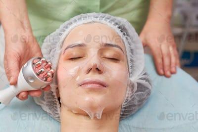 Young woman, facial collagen mask