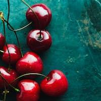Ripe cherries on green