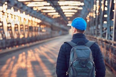 Tourist on the old iron bridge