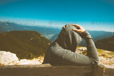 Depressed sad woman at high mountain viewpoint
