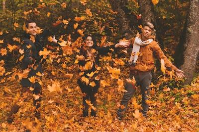 Friends having fun in autumn park