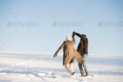 Beautiful senior couple on a walk, winter day.