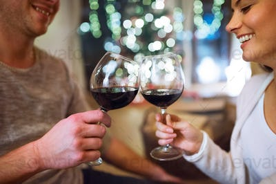 Couple at Christmas time, drinking wine.
