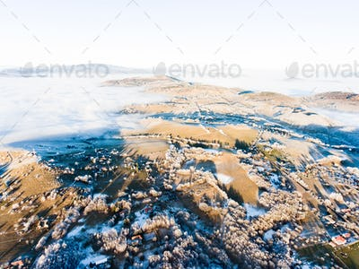 Aerial view of countryside in winter.