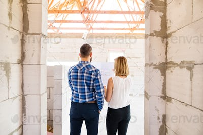 Young couple at the construction site.