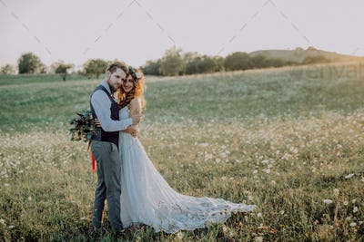 Beautiful bride and groom in green nature.