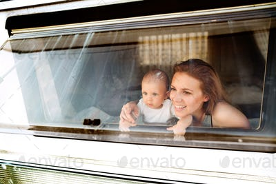 Mother and baby son in a camper van.
