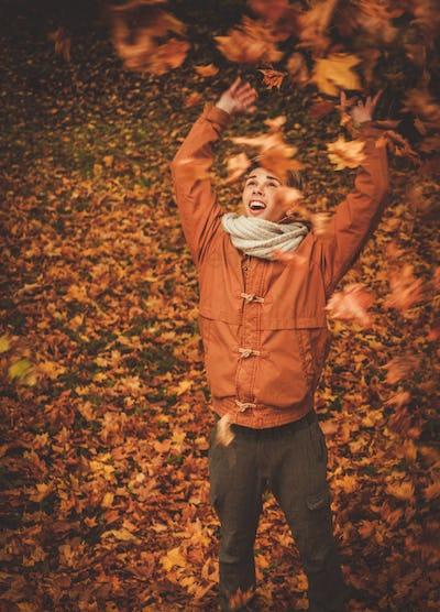 Man having fun in autumn park
