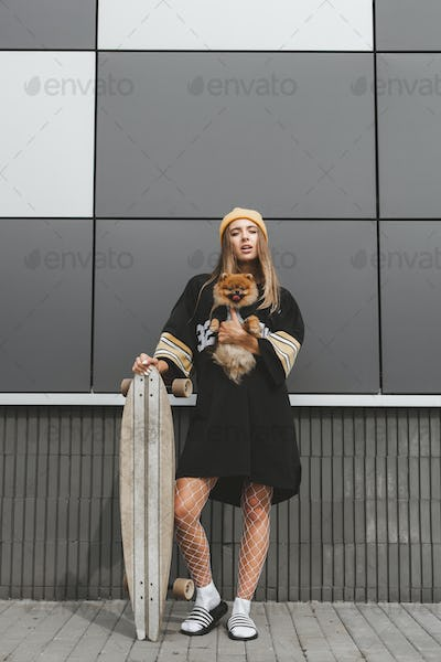 Girl with dog on longboard