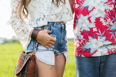 close up of young hippie couple outdoors