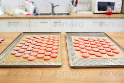 macarons on oven trays at confectionery