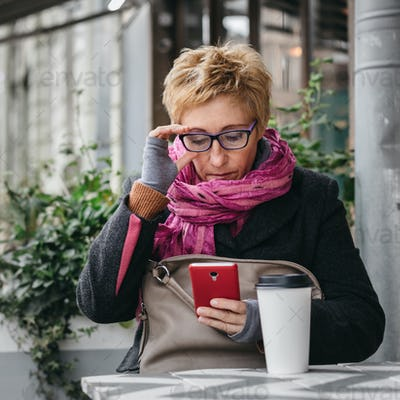 Adult woman surfing phone