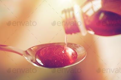 medication or antipyretic syrup and spoon