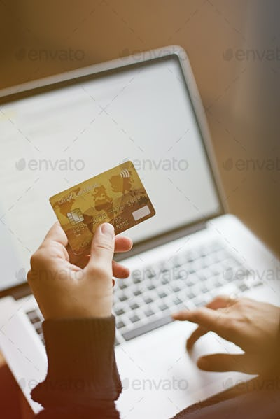 Woman using credit card for online purchase