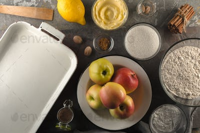 Apples, flour, lemon and spices for American apple pie