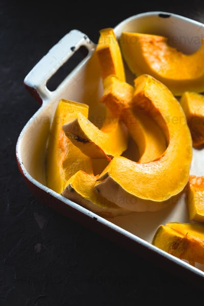 Large pieces of pumpkin in the baking dish free space