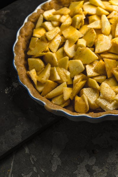 Raw apple pie for cooking for Thanksgiving, free space