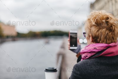 Woman taking shots from waterfront