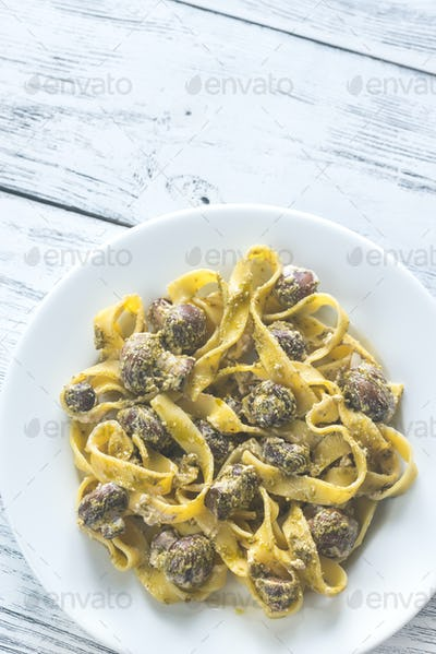 Portion of creamy mushroom pasta with pesto