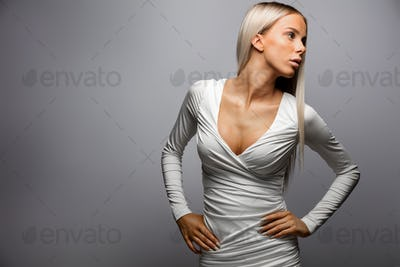 Beautiful Woman With Hands On Hip Looking Away