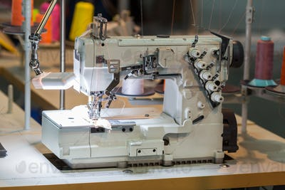 Sewing machine and cloth in cutting shop, nobody