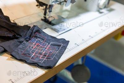 Sewing machine in cutting shop closeup, nobody