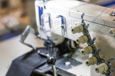 Sewing or overlock machine closeup, cloth industry