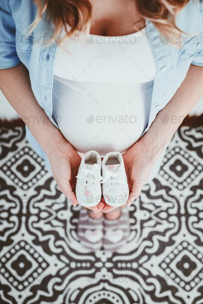Happy beautiful pregnant woman