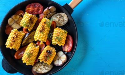 Baked in a frying pan corn and vegetables