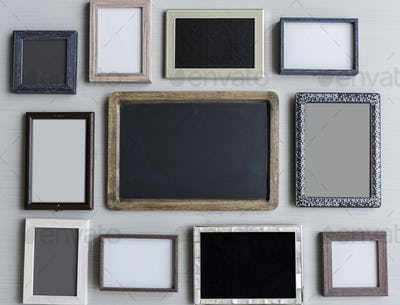 Set of Blank Photo Frames Hanging on Gray Wall