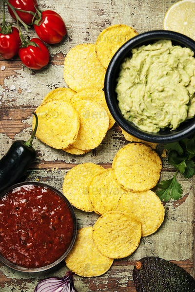 Mexican nachos chips with homemade fresh guacamole sauce and sal