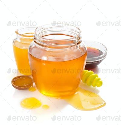 variety of honey in jar white background