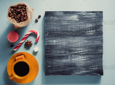 coffee cup and beans at colorful background