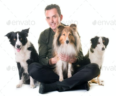 three dogs and man