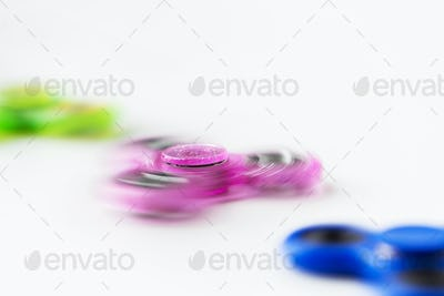 close up of spinning fidget spinners