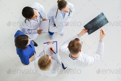 doctors with spine x-ray and clipboards
